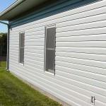 Фасад, отделка сайдингом - белого цвета